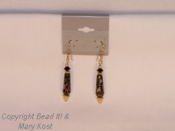 Black Cloisonne Teardrop earrings with  14 kt gold beads, 14 kt gold ear wires,  and 24 kt gold plated accent beads