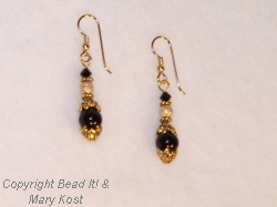 Black gemstsone and gold earrings