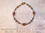 Copper metallic gemstone and Swarovski bracelet