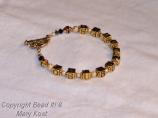 """OSU Buckeyes"" bracelet in gold tones"