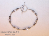 Clear crystal square and silver bracelet