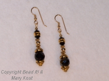 Black gemstsone and gold earrings