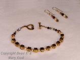 """OSU Buckeyes"" gold bracelet and earring set"