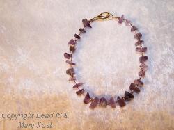 Amethyst gemstone and  14kt gold bracelet
