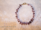 Amethyst gemstone and  14kt gold bracelet