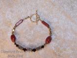 OSU letter bracelet with scarlet crackle beads