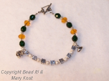 Packer Jewelry/silver 1, with initials and 2 charms