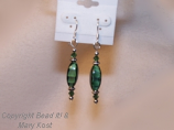 Malachite Gemstones combined with Swarovski Austrian crystals and silver  plated accent beads, with .925 Sterling silver earwires