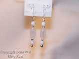 White glass beads and silver earrings