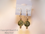 Malachite Gemstones and gold earrings