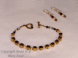 """OSU Buckeyes"" gold bracelet and earring set"